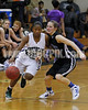 Southeast Raleigh's Alexus Hicks (15) drives around Clayton's  Jenna Harris (10).  Southeast Raleigh won the Greater Neuse River Conference game held at Southeast Raleigh High School 31-28. Photo by Dean Strickland OD.
