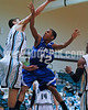 Clayton's Tre Clayton (12) battles West's Channing Joyner (50) for a rebound. Clayton won the Greater Neuse River Conference game 53-42 held at West Johnston High on February 7, 2012.  Photo by Dean Strickland OD.