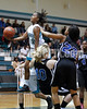West's Jarmelia Holder (30) charges over Clayton's Abby Durham (40) on her way to the basket. The Clayton girls won the Greater Neuse River Conference game 74-43 held at West Johnston High School on February 7, 2012. Photo by Dean Strickland OD.