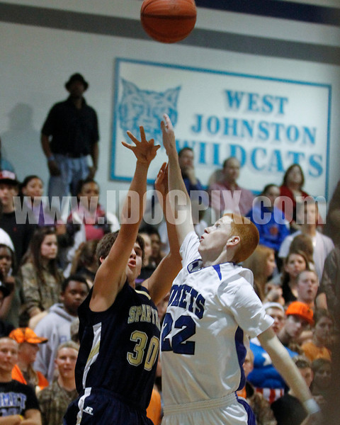 SSS's Seth Turner (30) gets off a shot over Clayton's Kyle Bryant (22). Clayton won the GNR Conference game 71-54  played at Clayton High on Feb. 3, 2012. Photo by Dean Strickland OD