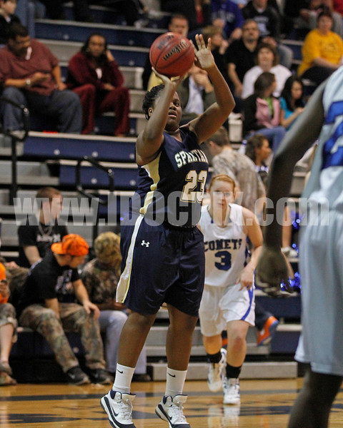 SSS's Sabrina Shepeard (23) gets by Clayton's Ashley Murphy (3 )and puts up one of her three's in 1st half action against Clayton.Clayton won the GNR Conference game 74-48 played at Clayton High on Feb. 3, 2012. Photo by Dean Strickland OD