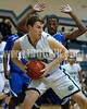 West's Blair Pietrowski (32)gets ready to make his move to the basket as Clayton's Adonis Banks (24) defends. Clayton won the Greater Neuse River Conference game 53-42 held at West Johnston High on February 7, 2012.  Photo by Dean Strickland OD.