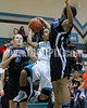 West Johnston's J.P. Preston (12) puts up a shot as Clayton's Vernessa Hinnant (14) tries to make the stop. Ashley Murphy (3) trails the play. The Clayton girls won the Greater Neuse River Conference game 74-43 held at West Johnston High School on February 7, 2012. Photo by Dean Strickland OD.