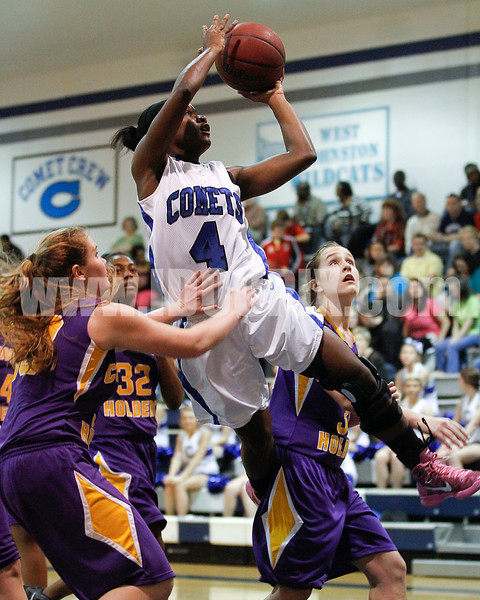 Clayton's Tajah Clark (4) gets between Corinth's Morgan Hester (30) and Holly Price (34).Photo by Dean Strickland OD.