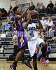 Corinth's Sam Gibson (44) tries to stop Comet Tajah Clark (4) as she drives to the basket.Photo by Dean Strickland OD.