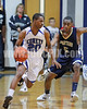 Clayton's Rodney Moore (20) drives around SSS's Quantez Leach (5) in 4th quarter action. Clayton won the GNR Conference game 71-54  played at Clayton High on Feb. 3, 2012. Photo by Dean Strickland OD
