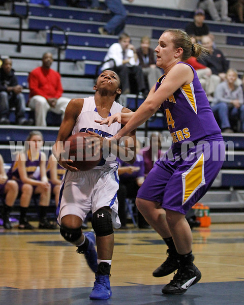 Corinth's Holly Price (34) tries to stop Clayton's Latesha Williams (12) drive to the basket.Photo by Dean Strickland OD.