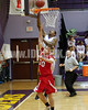 Ki-yon Walden gets by Franklinton's Will Oakes (30) for a lay up.