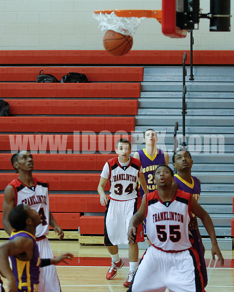 Kenny Collins watches one of his 3's swish the net.