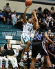 West's Shorty Frederick (21) puts up a shot over Clayton's Vernessa Hinnant (14). The Clayton girls won the Greater Neuse River Conference game 74-43 held at West Johnston High School on February 7, 2012. Photo by Dean Strickland OD.