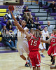 Kahlil Larry (5) get by Frankinton defender Perry(15) for the easy layup.