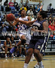 SSS's Sabrina Shepeard (23) tips the ball away from Clayton's Latesha Williams (12) to prevent the lay-up. Clayton won the GNR Conference game 74-48 played at Clayton High on Feb. 3, 2012. Photo by Dean Strickland OD