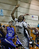 Southeast Raleigh's David Washington (11) draws the foul on Clayton's Adonis Banks (24) on his way to the basket.  Clayton won the Greater Neuse River Conference game 58-48  played at Southeast Raleigh High. Photo by Dean Strickland OD.