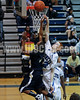 SSS's Montrel Shepard (20) gets a lay-up by CLayton's Kyle Bryant (22). Clayton won the GNR Conference game 71-54  played at Clayton High on Feb. 3, 2012. Photo by Dean Strickland OD