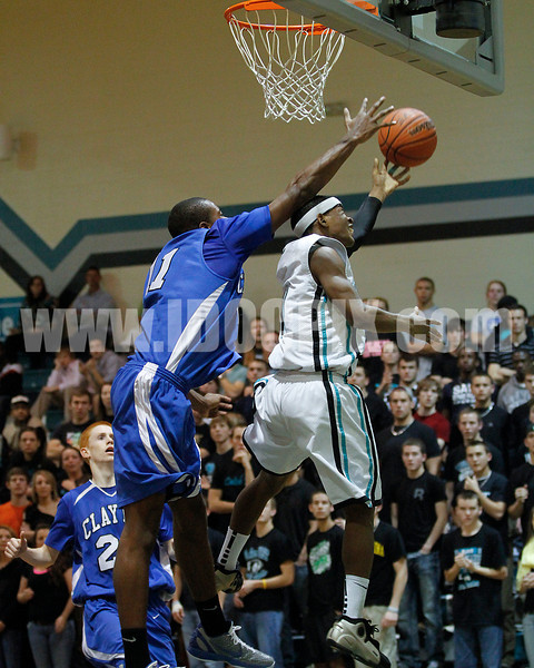 Clayton's Gary Clark (11) deflects West's Darius William's (11) shot in 4th quarter action.  Clayton won the Greater Neuse River Conference game 53-42 held at West Johnston High on February 7, 2012.  Photo by Dean Strickland OD.