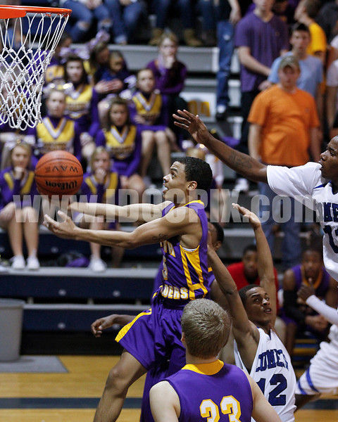 CHHS's Kahlil Larry (5) gets by CHS's Gary Clark and Tre Clayton. Photo by Dean Strickland OD.