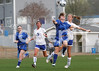 East Wake's Anna Riddle (14) heads the ball away from Clayton's Claudia Woznichak (9) as Sheby Hammond (3) and McKenzie Gairrett (20) watch the play.
