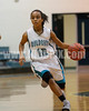West Johnston's J. P. Preston (12) brings the ball upcourt against Clayton's Comets. The Clayton girls won the Greater Neuse River Conference game 74-43 held at West Johnston High School on February 7, 2012. Photo by Dean Strickland OD.