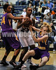 CHS's Jasmine Dixon (23) gets tied up by Corinth's Sam Gibson (44) and Lauren Keiser (5).Photo by Dean Strickland OD.