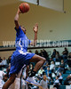 Clayton's Gary Clark (11) heads to the basket for one of his dunks. Clayton won the Greater Neuse River Conference game 53-42 held at West Johnston High on February 7, 2012.  Photo by Dean Strickland OD.