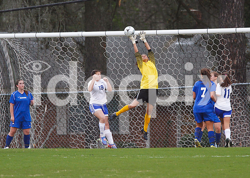 East Wake keeper deflects the cornerkick as Clayton's Kelly Phillips (19) looks for the header.