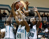 Clayton's Vernessa Hinnant (14) goes up for a shot as West's Eboni Robinson (10), Shorty Frederick (21) and Jarmelia Holder (30) surround her. The Clayton girls won the Greater Neuse River Conference game 74-43 held at West Johnston High School on February 7, 2012. Photo by Dean Strickland OD.
