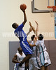 Clayton's Gary Clark (11) goes high for a shot over West Johnston defenders. <br /> Clayton won the Greater Neuse River Conference game 53-42 held at West Johnston High on February 7, 2012.  Photo by Dean Strickland OD.