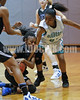 West Johnston's Avvette Smith (23) tries to wrestle the ball away from Clayton's Latesha Williams (12) in 1st quarter action.  The Clayton girls won the Greater Neuse River Conference game 74-43 held at West Johnston High School on February 7, 2012. Photo by Dean Strickland OD.