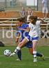 Clayton's Clare Orsega (7) shields the ball from East Wake's Breanna McShea (7).