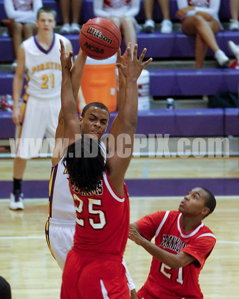 Corinth's Kahlil Larry (5) gets a pass through Franklinton defender Tyquon Crudup (26) for an easy lay up.