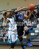 Clayton's Latesha Williams (12) is fouled by West's Avvette Smith (23) as she goes up for a lay-up. The Clayton girls won the Greater Neuse River Conference game 74-43 held at West Johnston High School on February 7, 2012. Photo by Dean Strickland OD.