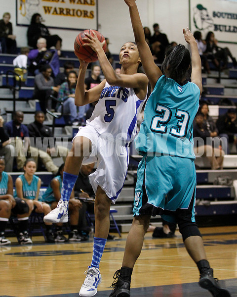 Clayton's Amber Caudle (5) goes up for a lay up as West's Avvette Smith (23) defends. Photo by Dean Strickland OD.