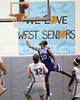 Clayton's Rodney Moore (20) puts up the alley oop off the backbloard for a basket as West's Blair Pietrowski (32). Clayton won the Greater Neuse River Conference game 53-42 held at West Johnston High on February 7, 2012.  Photo by Dean Strickland OD.