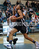 Clayton's Vernessa Hinnant (14) is fouled by West's Tanay Smith (11) as she drives to the basket. The Clayton girls won the Greater Neuse River Conference game 74-43 held at West Johnston High School on February 7, 2012. Photo by Dean Strickland OD.
