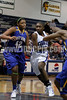 Clayton High's Jasmine Dixon (23) drives the lane as East Wakes S. Tanner (42) defends.