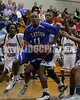 Clayton's Gary Clark (11) readies his move to the basket as Southeast Raleigh's Brockston Blount (34) attempts to defend.  Clayton won the Greater Neuse River Conference game 58-48  played at Southeast Raleigh High. Photo by Dean Strickland OD.
