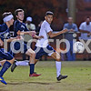 Smithfield-Selma's Jhonny Verntura (4) and Cleveland's Garrett Lee (left) and George Venturella (middle) chase a through ball late in the game. Cleveland defeated Smithfield-Selma 2-1 to clinch the Two Rivers Conference regular season title played in Smithfield, N.C. on Thursday, October 29, 2015.