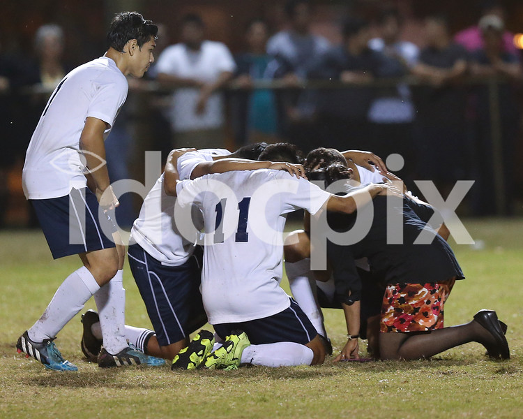 Smithfield-Selma players kneel in prayer as Cleveland's Dylan Bradford lay unconscious on the field for several minutes. Cleveland defeated Smithfield-Selma 2-1 to clinch the Two Rivers Conference regular season title played in Smithfield, N.C. on Thursday, October 29, 2015.