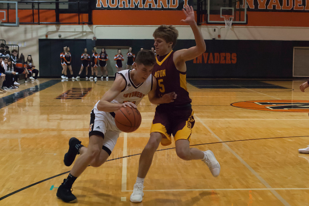 . Jen Forbus - The Morning Journal<br> Avon Lake\'s Cole Schraff tries to prevent Normandy\'s Milan Markovic from driving to the basket on Jan. 2.