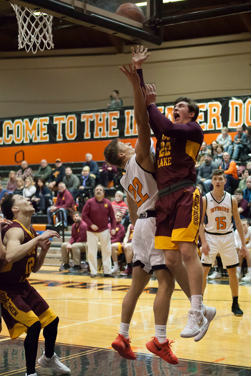 . Jen Forbus - The Morning Journal<br> Avon Lake\'s Nick Marsh forces his way up to the basket around Normandy\'s Ryan Dengler on Jan. 2.