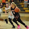 Paul DiCicco - The News-Herald<br />  North's Ally Lako dribbles past several Brush Arcs on her way to the basket.