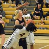 Paul DiCicco - The News-Herald<br /> Brush Arc Danajah Sanders draws a charge late in the game.