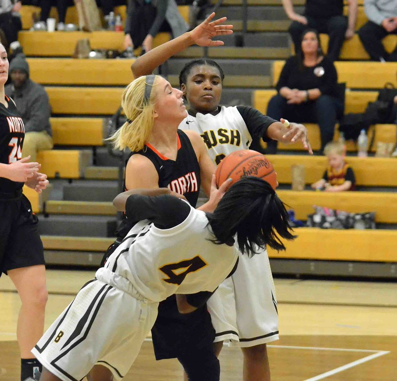 . Paul DiCicco - The News-Herald Brush Arc Danajah Sanders draws a charge late in the game.