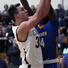 Randy Meyers - The Morning Journal<br /> Wellington's Trey Bealer drives and scores against Javon Todd of Clearview during the first quarter on Jan. 10.
