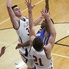 Randy Meyers - The Morning Journal<br /> Javon Todd of Clearview puts up a shot over Trey Bealer and Josh Kindel (21) of Wellington on Jan. 10.