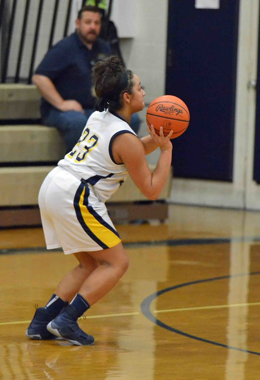 . Paul DiCicco - The News-Herald Wickliffe�s Stephanie Martin, launching a 3-pointer.