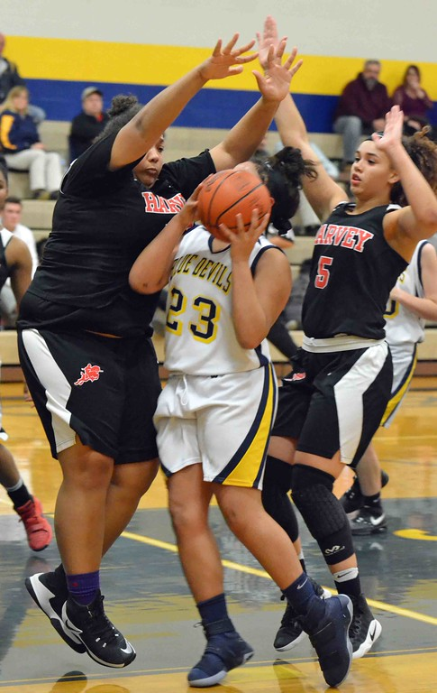 . Paul DiCicco - The News-Herald Harvey�s smothering defense ends Stephanie Martin�s trip to the basket.