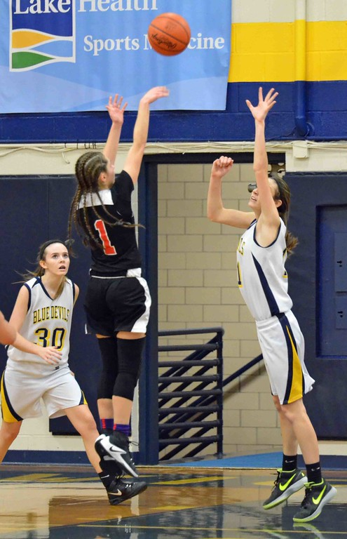 . Paul DiCicco - The News-Herald Harvey�s Jillian Hach shooting over Wickliffe�s Mary Burkett in the fourth quarter.