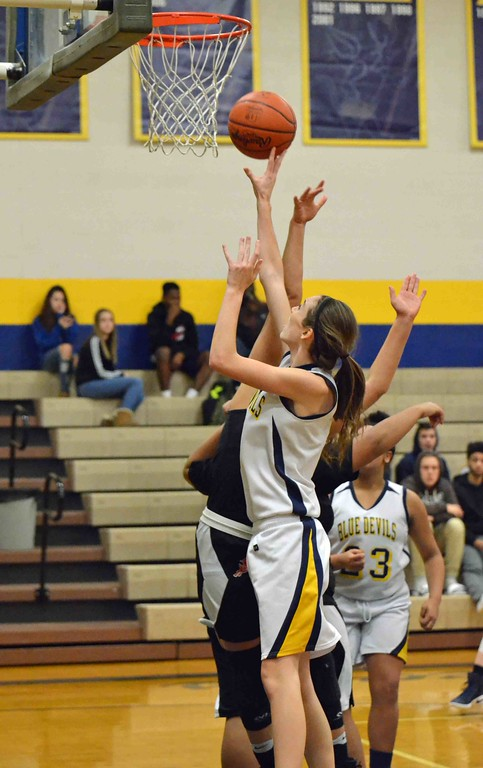. Paul DiCicco - The News-Herald Wickliffe�s Mary Burkett makes a layup.