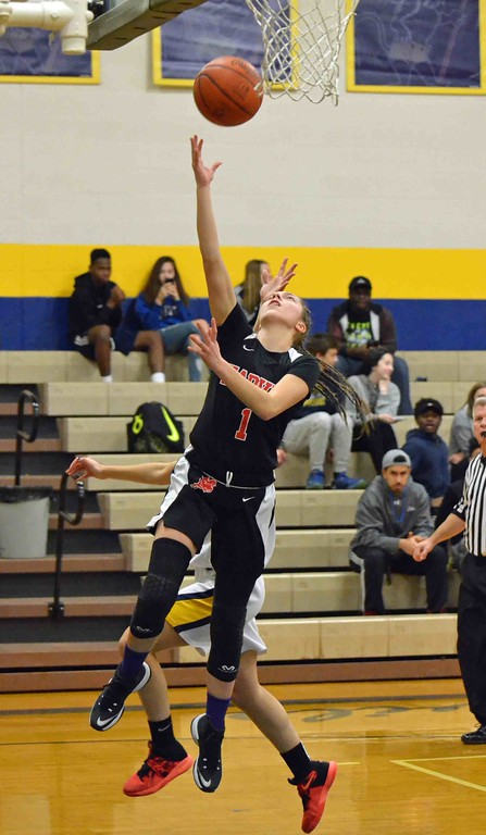 . Paul DiCicco - The News-Herald Harvey�s Jillian Hach shoots a layup late in the first quarter against Wickliffe.